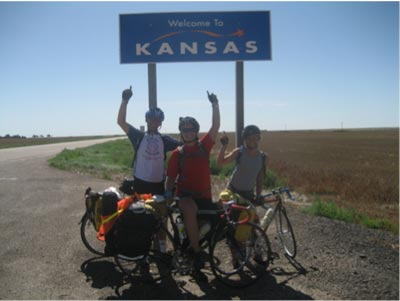 in front of kansas sign on bikes