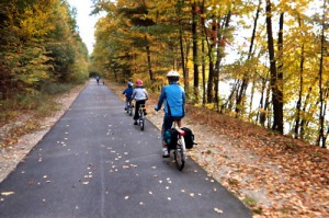 a family bicycle touring during autumn